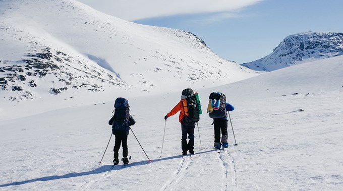Foto personer på skitur